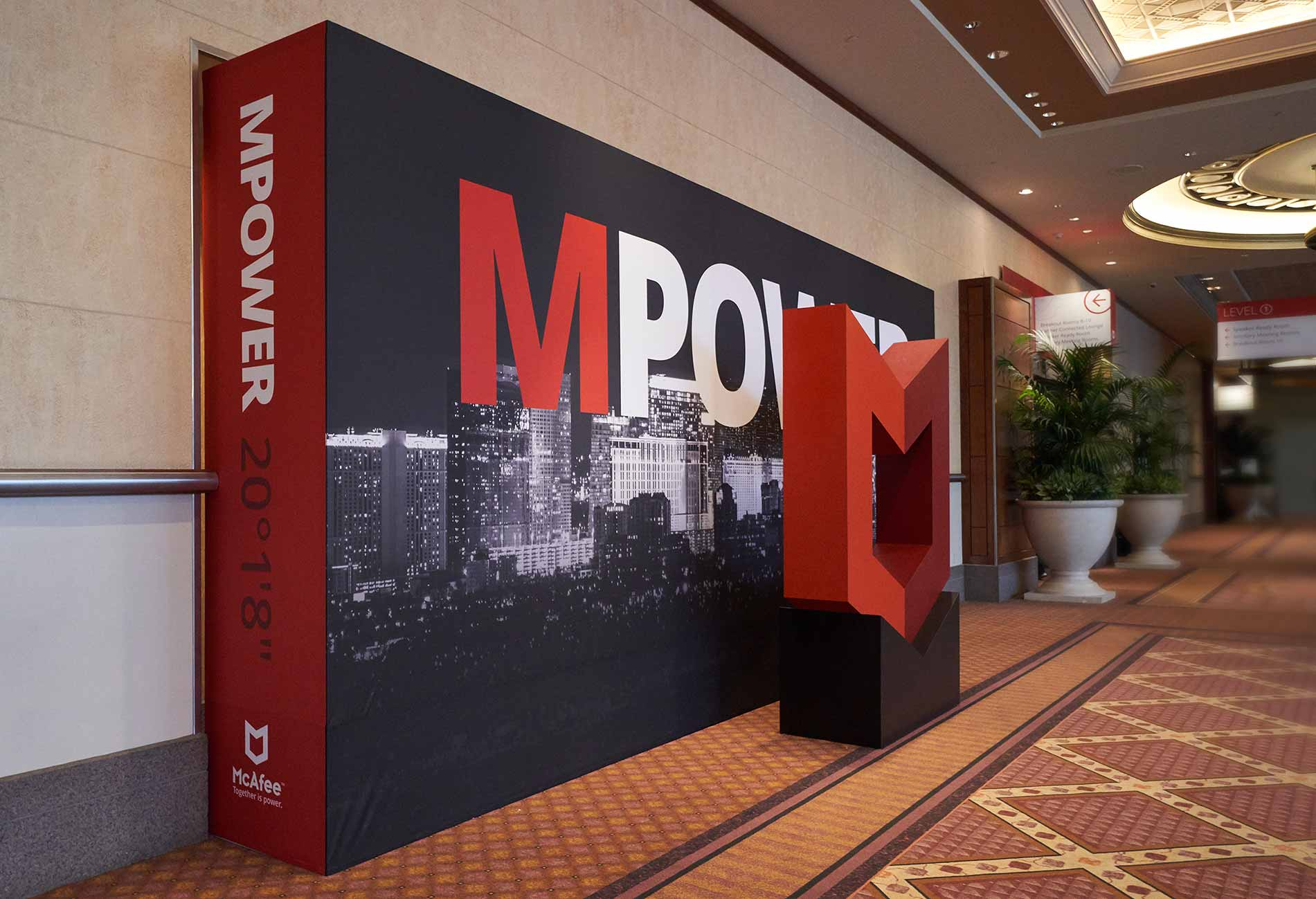 McAfee MPOWER Cybersecurity Summit photo opportunity plinth logo and signage backdrop designed by Giselle Dale
